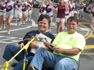 Nancy Lokai-Baldwin, president of the Simon Kenton Pathfinders, rides with her husband, Frank, in Urbana's Springfest Parade in May, in celebration of National Bike Month.
