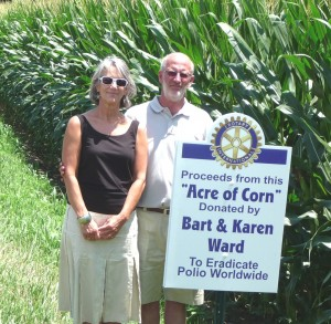 Karen and Bart Ward by their Acre of Corn.