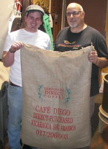 Paul Kurtz and his son-in-law Hans Hochstedler display a bag of Cafe Diego, coffee they purchased directly from a farmer in Nicaragua.