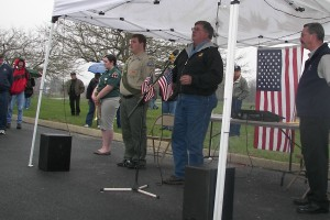 Fred Maine, who transported the WTC beam from New York, speaks Saturday at Freedom Grove.