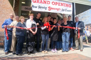 Jeff Donay cuts the ribbon to mark the store's transition to its new name, Carmazzi's Corner, a tribute to the Carmazzi family's many years of dedicated service to their customers and community.